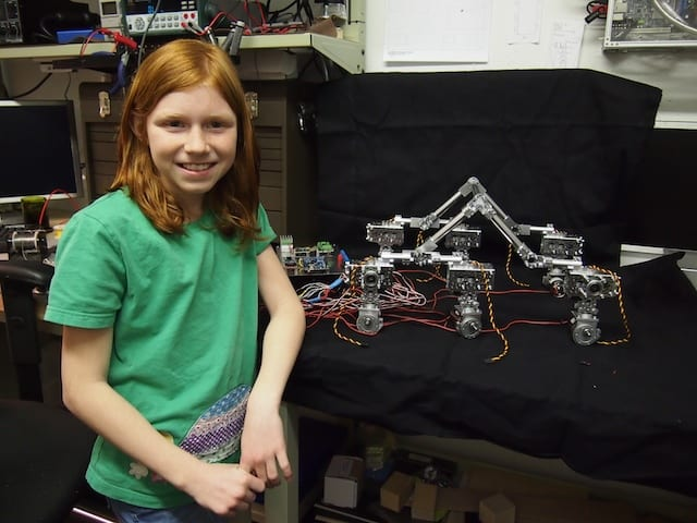 Genevieve in front of the Mars Rover chassis