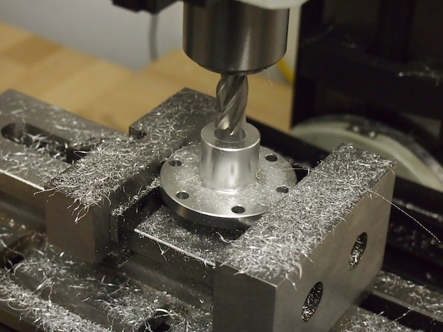 Here we are using our new vertical mill to machine the center hole of the hub.