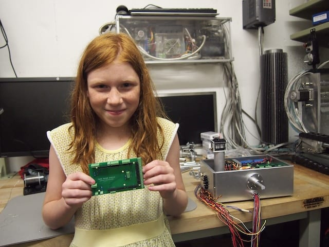 Genevieve showing off her newly soldered Mars Rover Shield. 165 solder points!